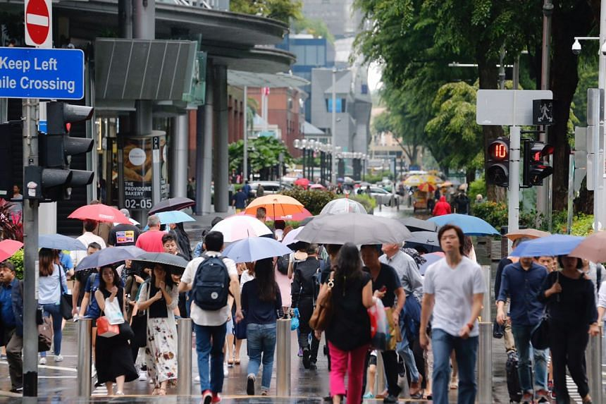With the drop in temperatures, people are wearing warmer clothing around Singapore.