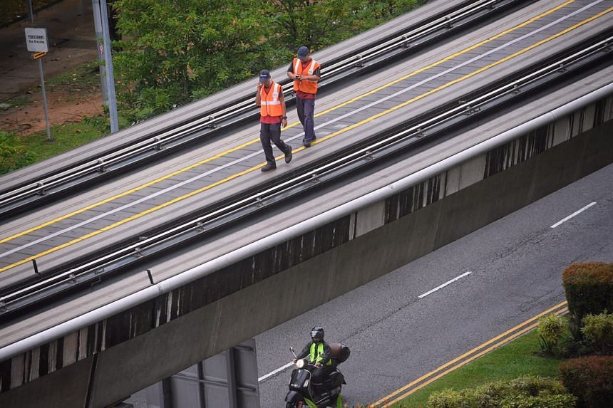 Staff members inspecting the lines from Bukit Panjang Station to Petir Station.
