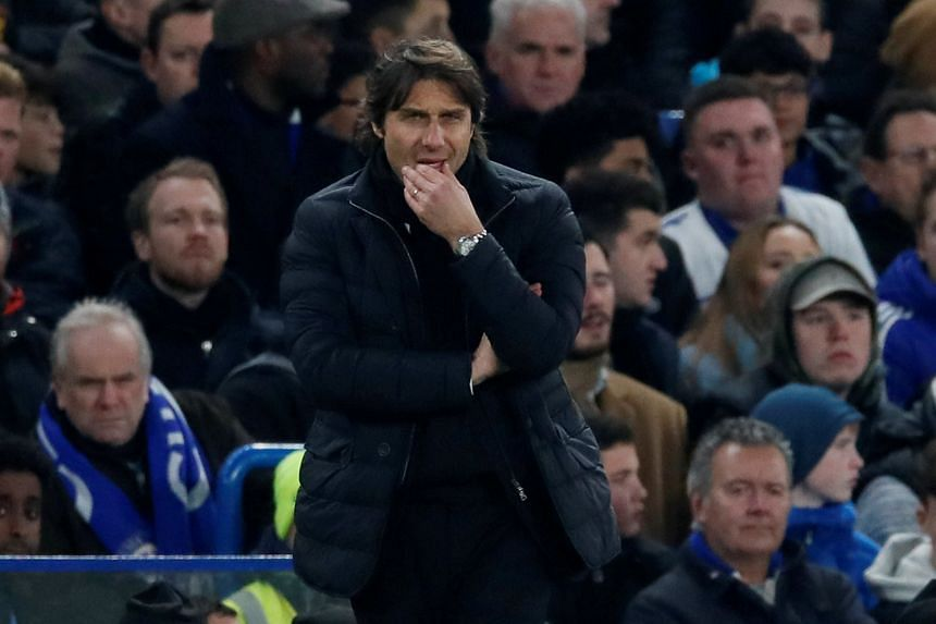 Conte (above) has signed an improved contract but it was not an extension to his deal, which still expires in June 2019.