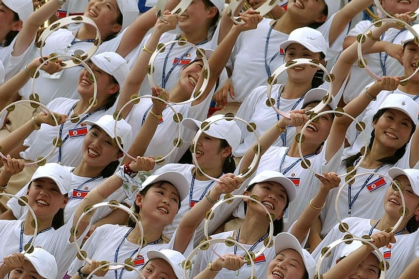 """North Korea's female cheerleaders are cherry-picked by the regime based on tough criteria - they must be more than 163cm tall and come from """"good"""" families."""