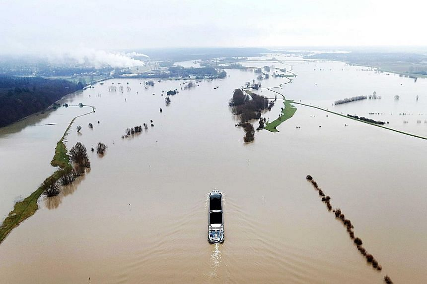An aerial view of high water levels in Doornenburg, The Netherlands, this week. Heavy rain and melting snow have raised water levels in Dutch rivers.