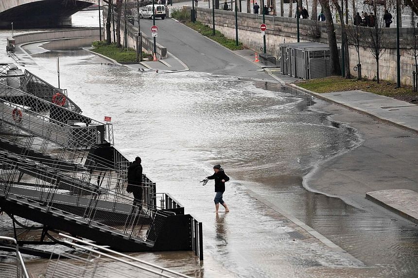 The river Seine burst its banks in Paris, in the wake of Storm Eleanor last week.