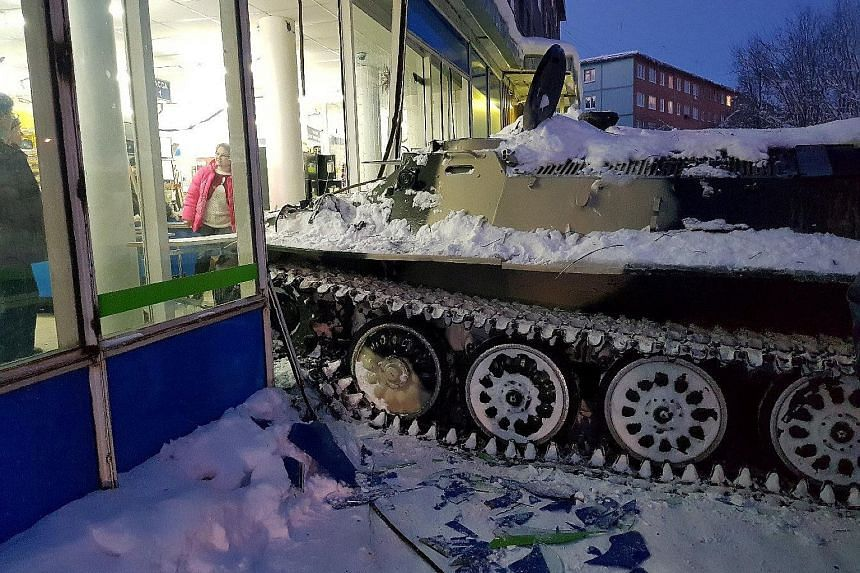 The scene of the incident at the shop in the town of Apatity, Russia, on Wednesday. The man had swiped the vehicle from a privately run motorsport training ground nearby, and driven it through a forest and into the small town just south of the Arctic