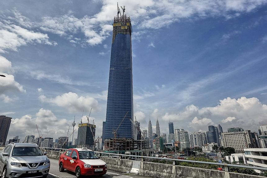 The 106-storey The Exchange 106 in Kuala Lumpur, slated for completion by the end of this year, will be 40m taller than the landmark Petronas Twin Towers (centre, in the background), which is currently Malaysia's tallest skyscraper.