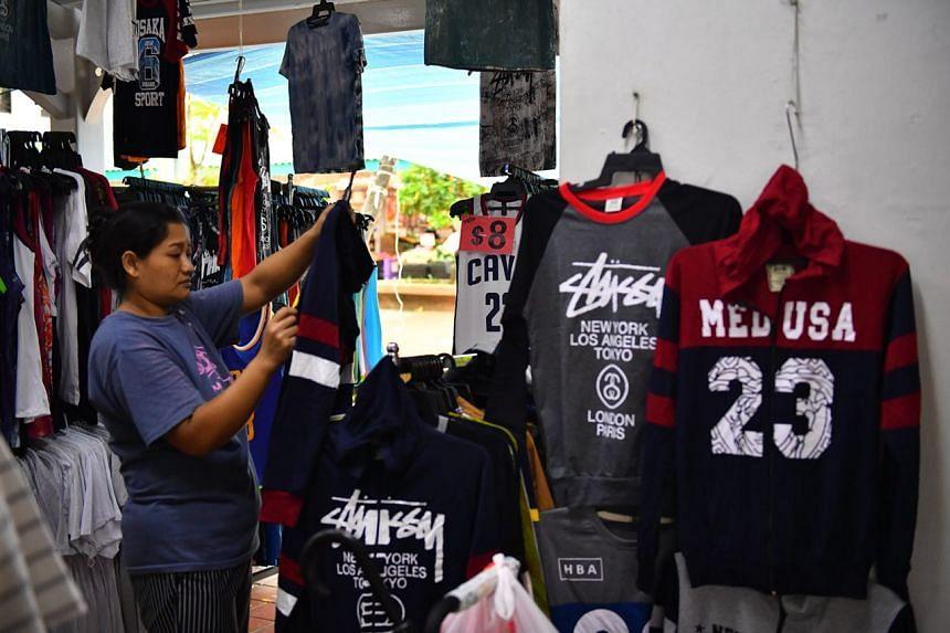 A woman chooses a sweater at a shop at Blk 442 Pasir Ris Drive 6, on Jan 12, 2018.