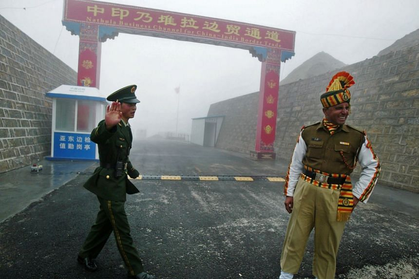 This file photo taken on July 10, 2008, shows a Chinese soldier next to an Indian soldier at the Nathu La border crossing between India and China in India's northeastern Sikkim state.