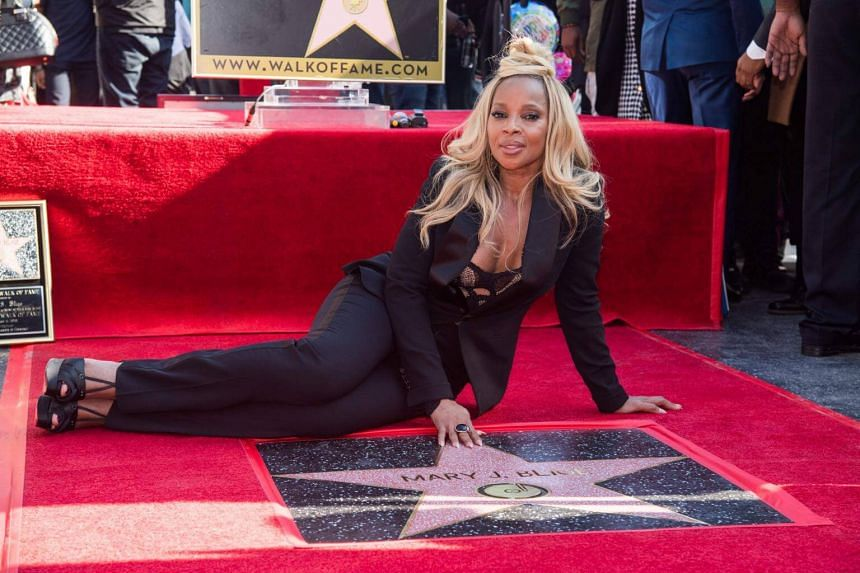 Grammy-winning soul singer Mary J. Blige poses with her star on the Hollywood Walk of Fame in Hollywood, California, US, on Jan 11, 2018.