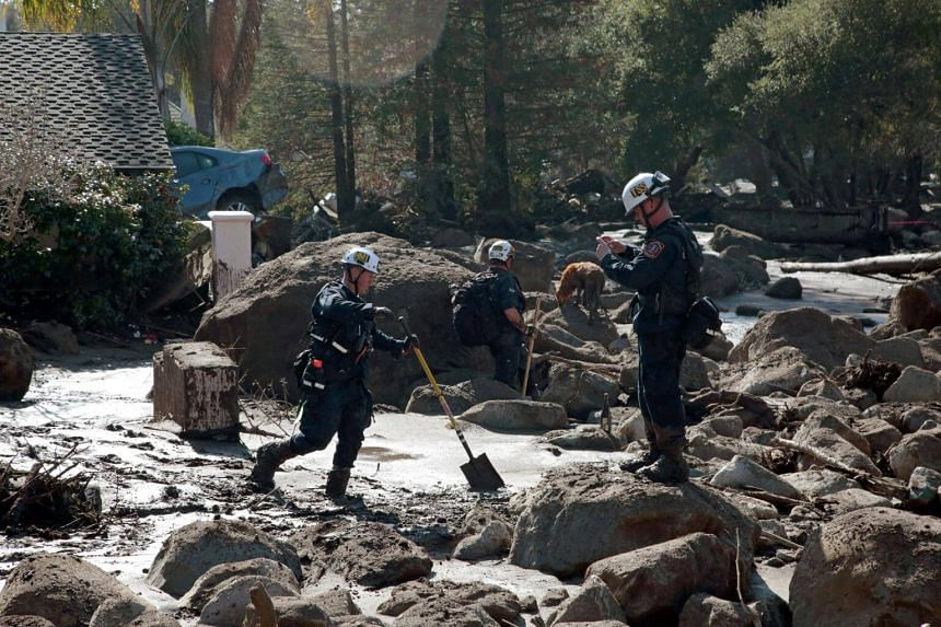 Rescue workers search through properties after a mudslide in Montecito, California, on Jan 11, 2018.