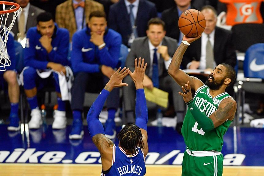 Boston Celtics guard Kyrie Irving  shoots the ball against Philadelphia 76ers forward Richaun Holmes during the second quarter at The O2 Arena.