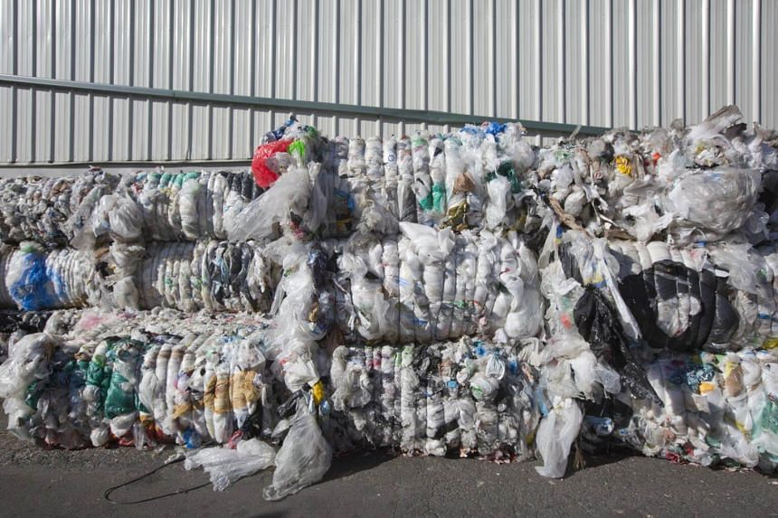 China had been processing at least half the world's exports of waste paper, metals and used plastic.