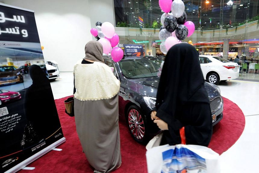 Women tour a car show in Jeddah, on Jan 11, 2017. The exhibition focused on fuel-efficient cars and targeted female drivers.
