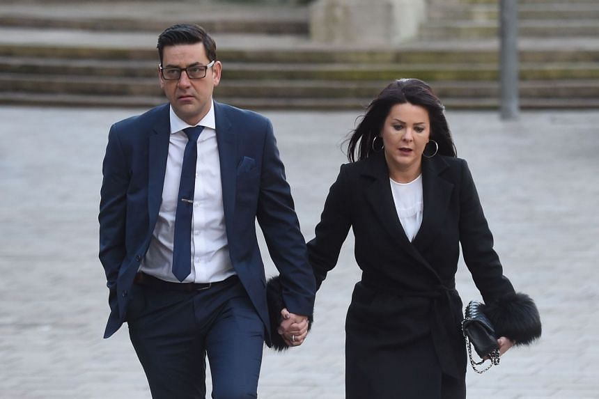 Former footballer and abuse victim Andy Woodward arrives at court with his partner Zelda for the first day of the trial of former football coach Barry Bennell.