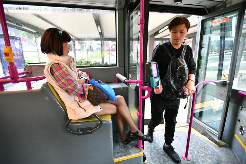 A passenger donning winter clothing on a bus on Friday (Jan 12).