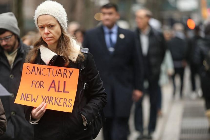 Hundreds of immigration activists, clergy members and others participate in a protest against President Donald Trump's immigration policies in front of the Federal Building on Jan 11, 2018 in New York City.