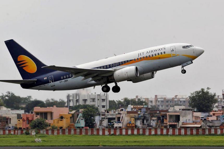 A file photo of a Jet Airways passenger aircraft taking off from the airport in the western Indian city of Ahmedabad, India.