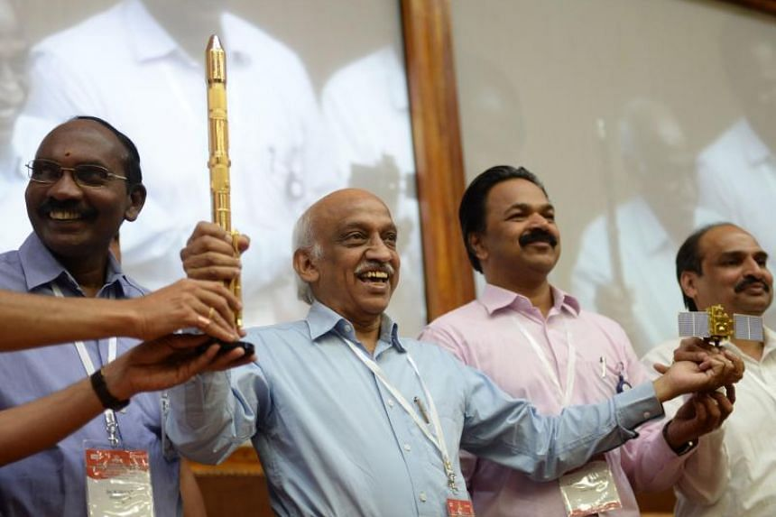 Indian Space Research Organisation chairman Kiran Kumar Reddy (centre) gestures while meeting with the media after the Indian Space Research Organisation's (ISRO) earth observation satellite CARTOSAT-2 was launched at Satish Dawan space center in Sri