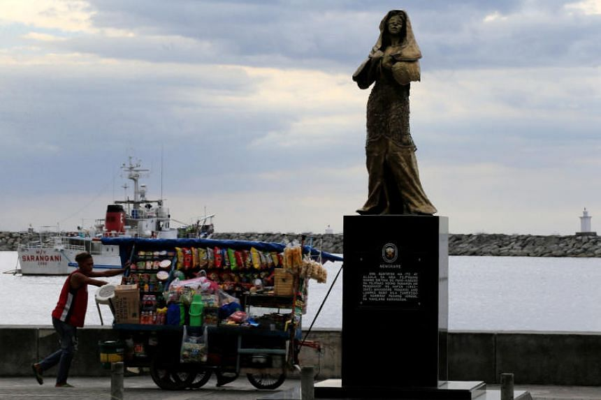 """A memorial statue that commemorates the Filipino """"comfort women"""" who worked in Japanese military brothels during World War II, erected along a main street of Roxas Boulevard, Metro Manila, Philippines on Jan 12, 2018."""