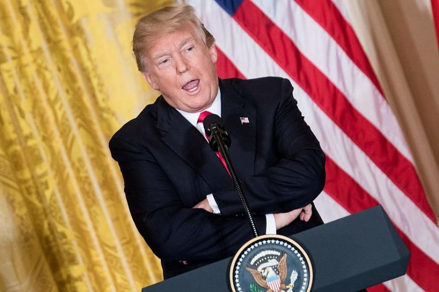 US President Donald Trump at a press conference in the East Room of the White House in Washington, DC on Jan 10, 2018.