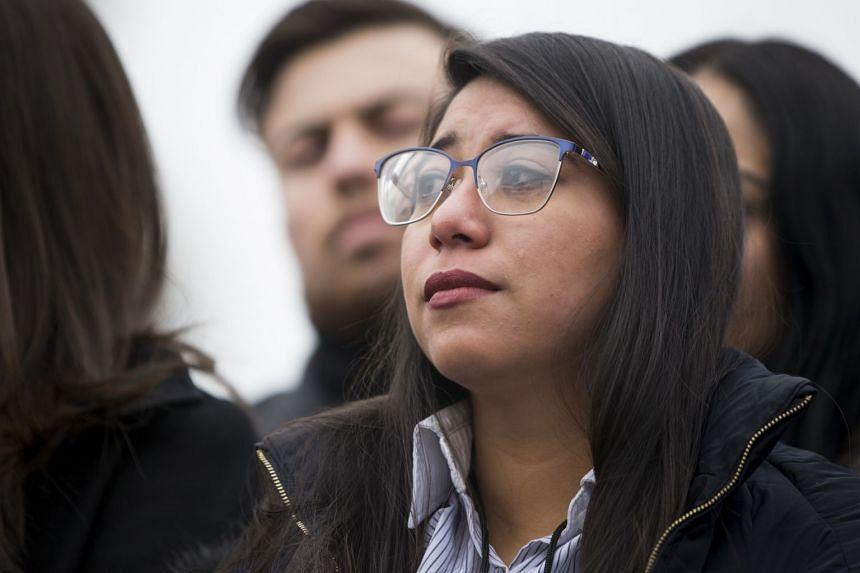 "Claudia Llewellyn listens as lawmakers speak in favour of a solution for the ""Dreamers"", on Capitol Hill in Washington."