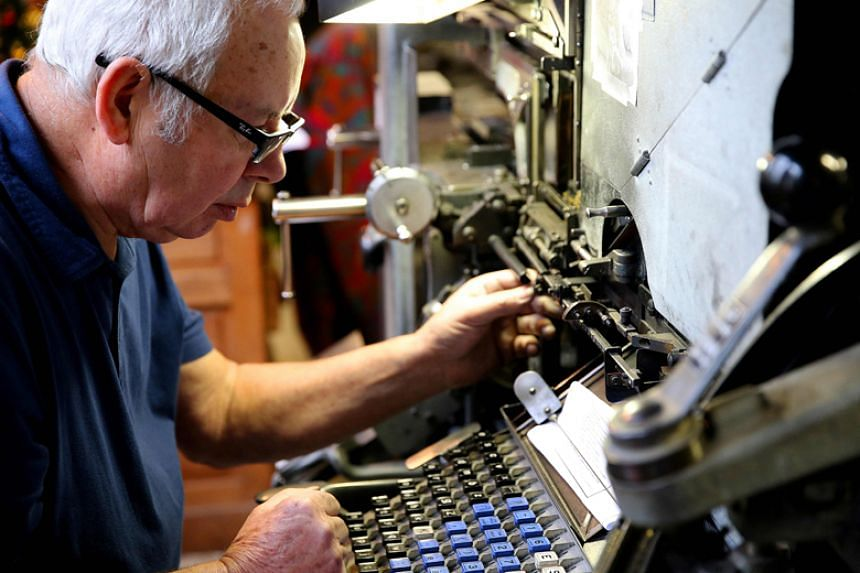 A man works on a linotype machine in the printing company's workshop of the Democrate de l'Aisne in Vervins, France, on Jan 2.
