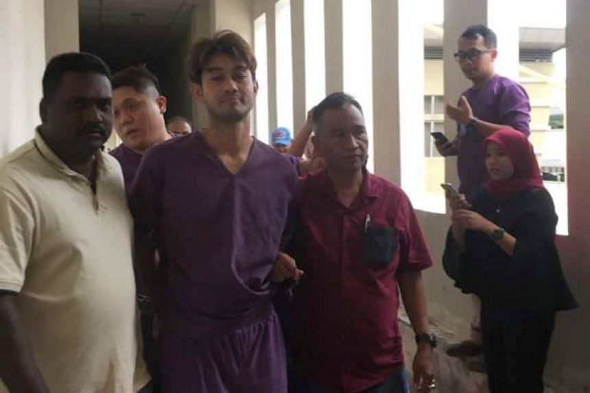 Malaysian actor Farid Kamil being led to the magistrate's court in Petaling Jaya on Jan 12, 2018.
