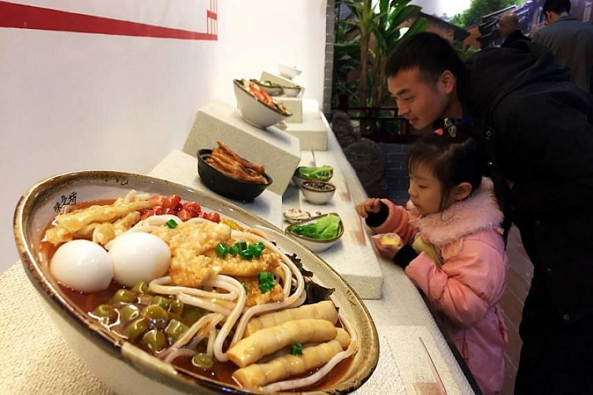 Visitors at the Liuzhou Luosifen Food and Culture Museum in Liuzhou city, south China's Guangxi Zhuang autonomous region, on Jan 7, 2018. The museum takes visitors on a journey of the history, production process, and development of luosifen, or rice
