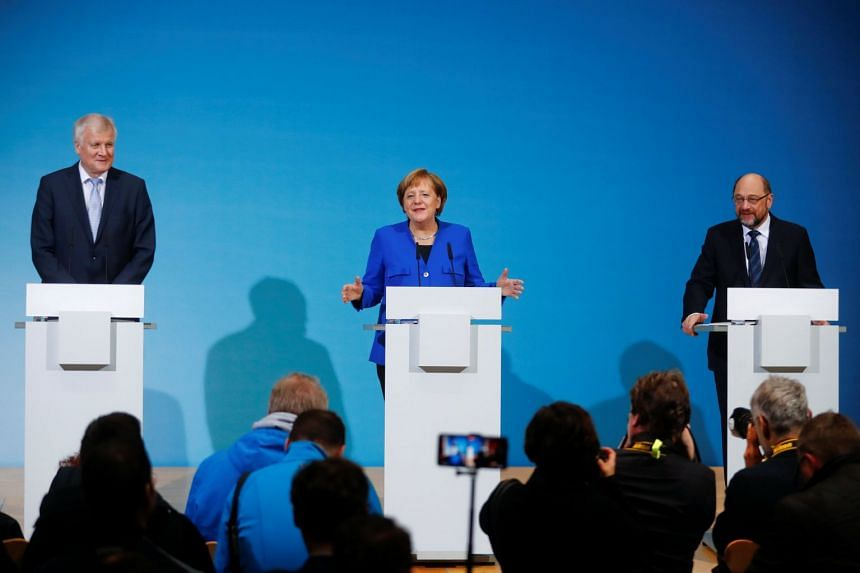 Acting German Chancellor Angela Merkel, leader of the Christian Social Union in Bavaria (CSU) Horst Seehofer and Social Democratic Party (SPD) leader Martin Schulz attend a news conference in Berlin, Germany, on Jan 12, 2018.