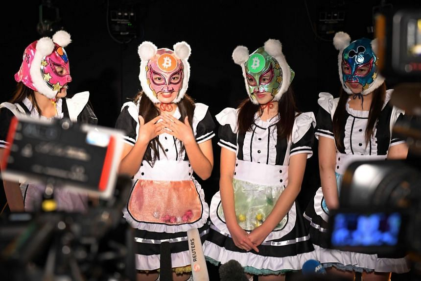 Members of idol group Kasotsuka Shojo (Virtual Currency Girls) attend an interview following their live stage performance in Tokyo on January 12, 2018.