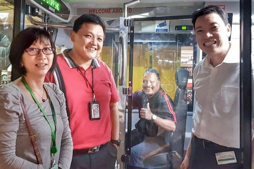 National Transport Workers' Union executive secretary Melvin Yong  (left) taking a tour inside one of the buses that was fitted with impact-resistant screens to protect bus drivers on Jan 12, 2018.