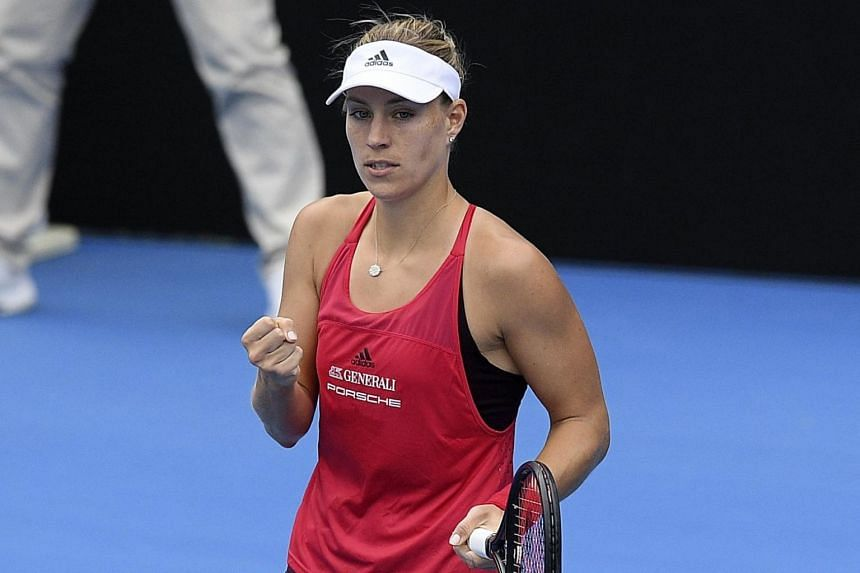Germany's Angelique Kerber (pictured) reacts against Ashleigh Barty of Australia during their women's finals match at the Sydney International Tennis Tournament on Jan 13.