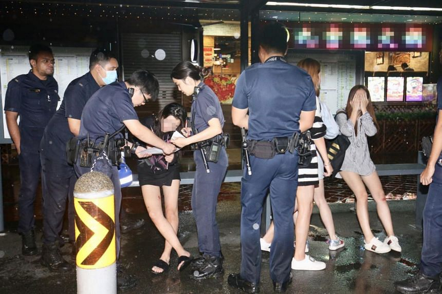 Police officers and paramedics responding to the incident that took place at Bugis Cube on Jan 13, 2018.