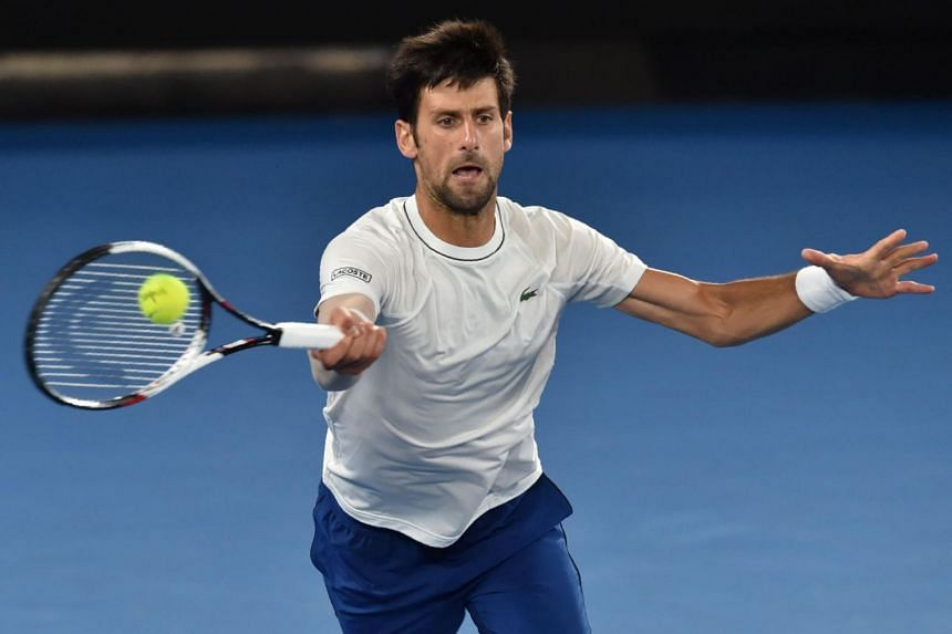 Serbia's Novak Djokovic hits a return during a practice session ahead of the Australian Open tennis tournament in Melbourne.