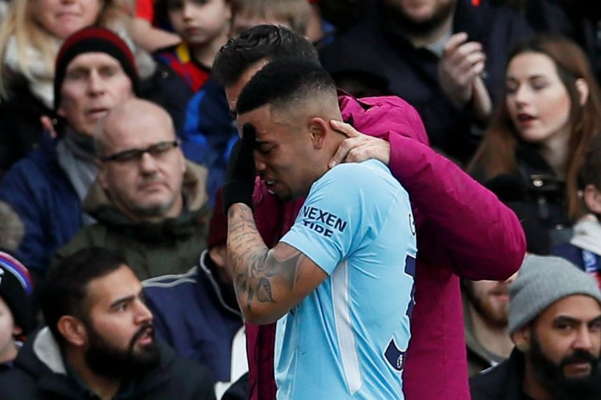 Manchester City's Gabriel Jesus goes off injured against Crystal Palace.