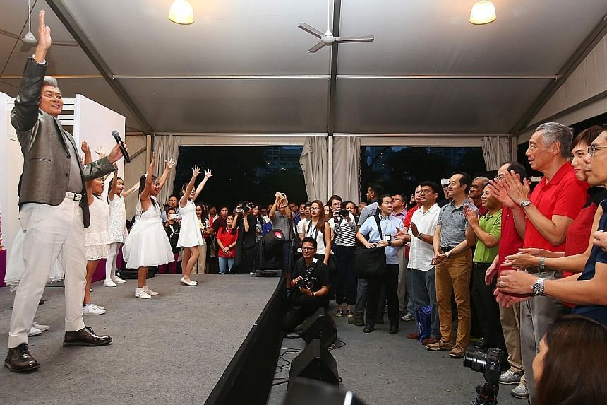 Singer-songwriter Dick Lee performing the Asean theme song Rise at the Experience Asean festival yesterday. Watching the performance are (from right) Senior Minister of State Maliki Osman, Minister in the Prime Minister's Office Josephine Teo, Prime