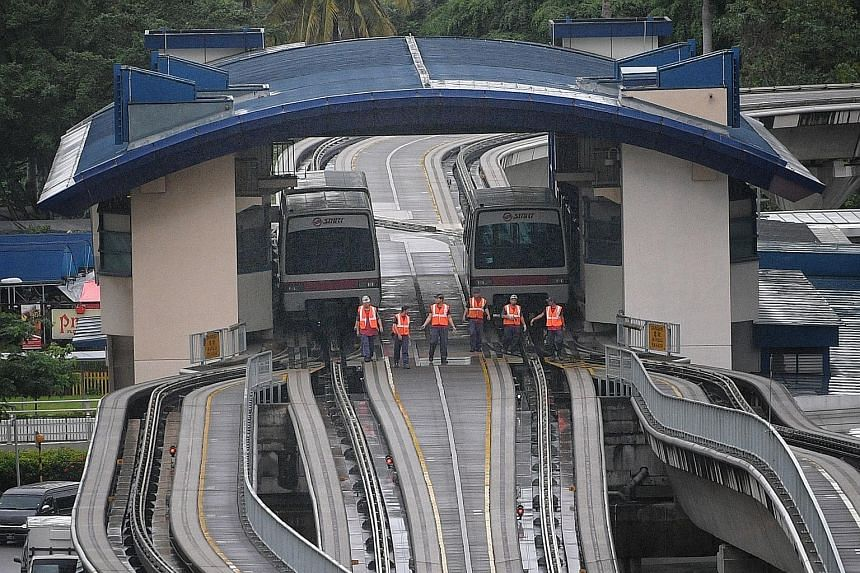 SMRT staff inspecting the tracks of the Bukit Panjang LRT yesterday after the incident. A systemwide safety check was conducted to determine whether other parts of the LRT system had also been damaged. The LRT service resumed at 6.30pm.