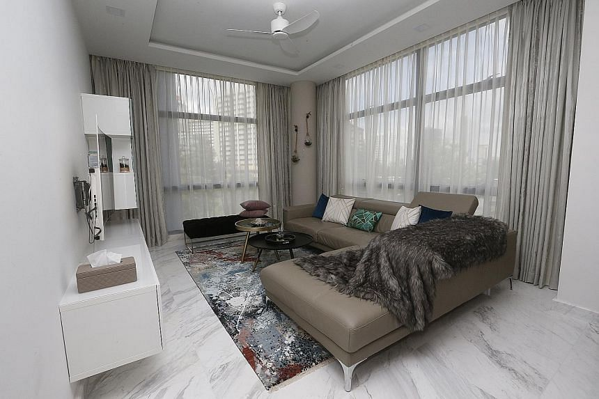 Marble flooring (top) gives the apartment of Ms Rashi Tulshyan and Mr Rahul Daswani (above) a luxe feel. The kitchen, which adjoins the dining area (left), is fitted with cabinetry from Ikea. An earthy palette gives this bedroom (above) a warm and co