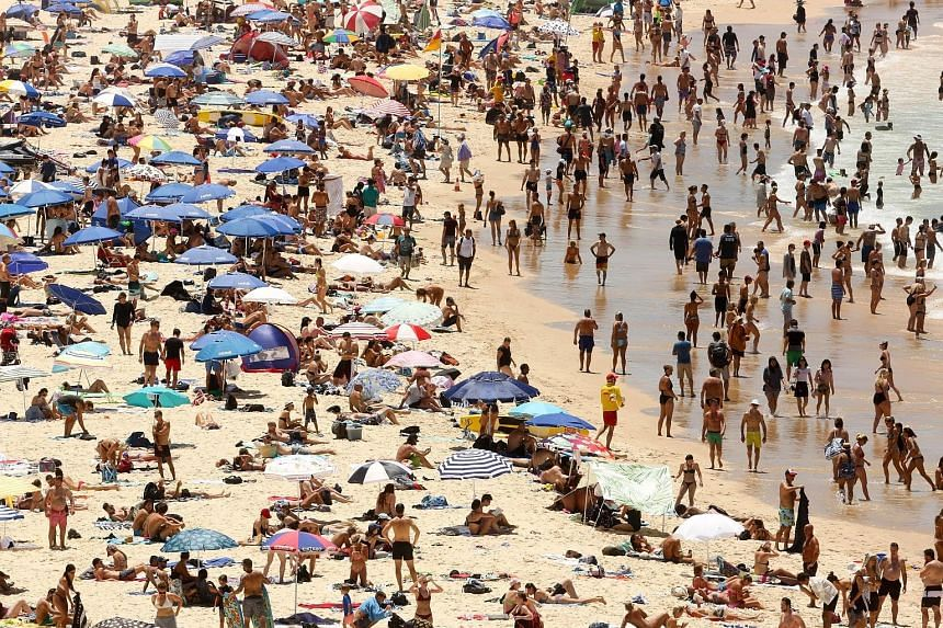 Beachgoers out in force on Sydney's Bondi beach on Sunday, when the Australian city saw its hottest day since 1939 as the mercury exceeded 47 deg C. A UN draft report says average temperatures are on track to reach 1.5 deg C above pre-industrial time