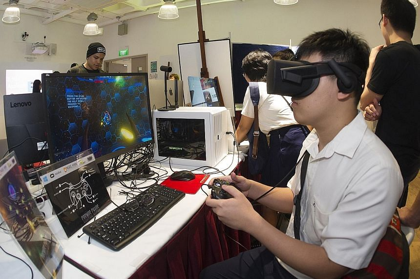 A student trying out augmented reality at Ngee Ann Polytechnic's School of InfoComm Technology. Polytechnics are more suited to those who enjoy hands-on learning.