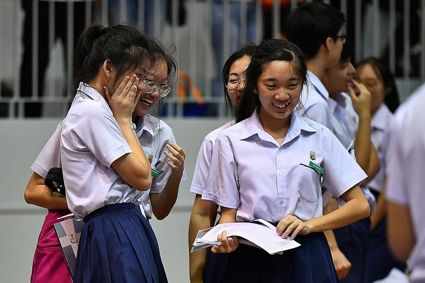 Students at Presbyterian High School receiving their GCE O-level examination results yesterday. No matter how a student fares in the O-level examinations, there will always be a pathway suited for him to explore, be it a junior college, polytechnic o