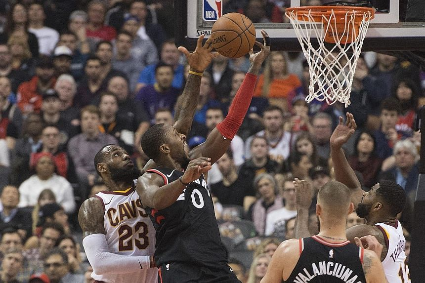 Toronto forward C.J. Miles driving to the basket against Cleveland forward LeBron James at Air Canada Centre. It is the first time James has lost successive games by at least 25 points.