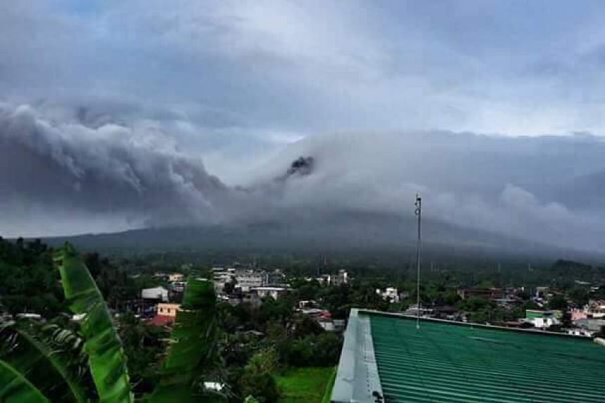 A photo posted to social media showing ash coming from the Mayon volcano.