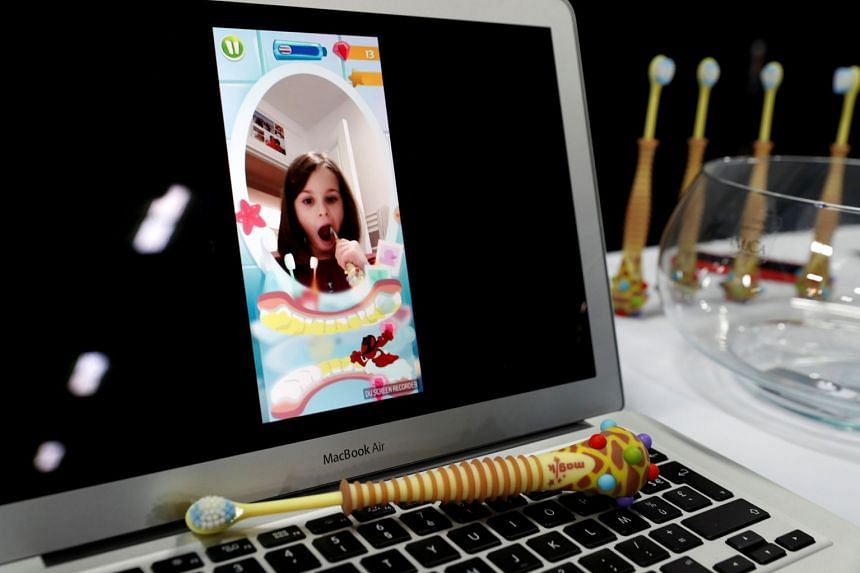 A Magik augmented reality toothbrush for children by Kolibree on display at CES 2018.