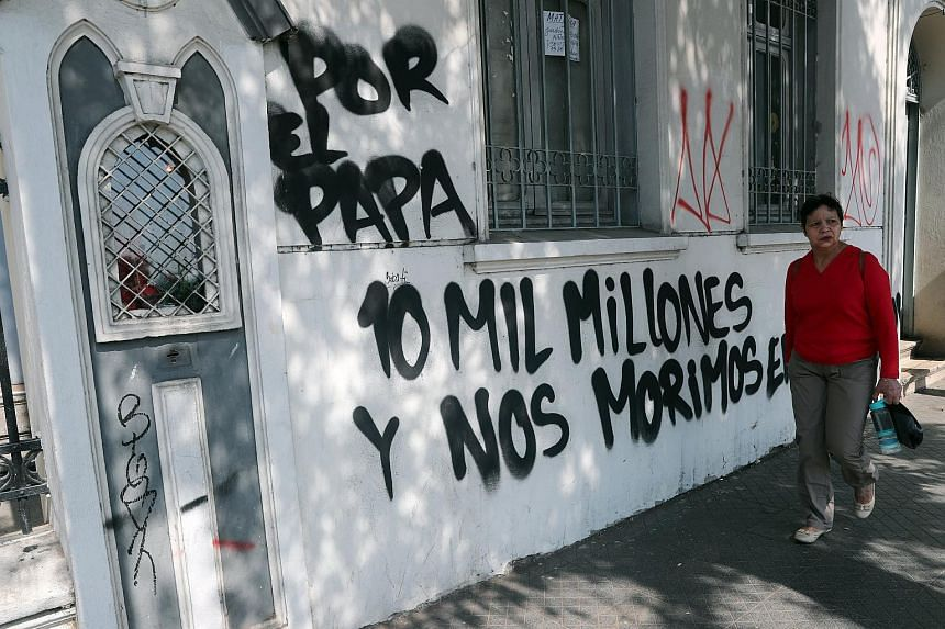 The Cristo Pobre Church facade walls were painted with messages against Pope Francis' visit in Santiago, Chile, on Jan 12, 2018.