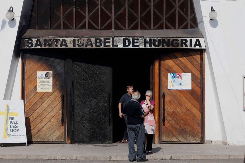 The burnt door of Santa Isabel de Hungria church in Santiago, where an attack with an incendiary device occurred and a threatening message against the pontiff was placed, on Jan 12, 2018.