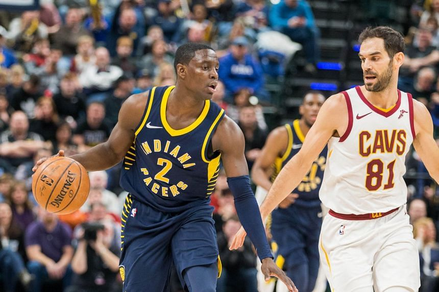Indiana Pacers' Darren Collison dribbles the ball while Cleveland Cavaliers' Jose Calderon defends in the second half of the match at Bankers Life Fieldhouse on Jan 12.