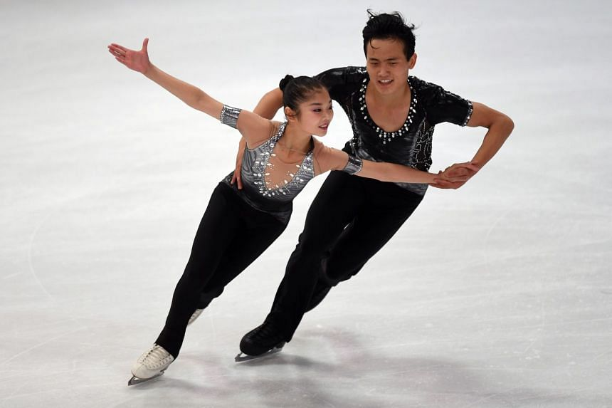 Ryom Tae Ok and Kim Ju Sik of North Korea performing during their pairs short programme of the 49th Nebelhorn trophy figure skating competition.