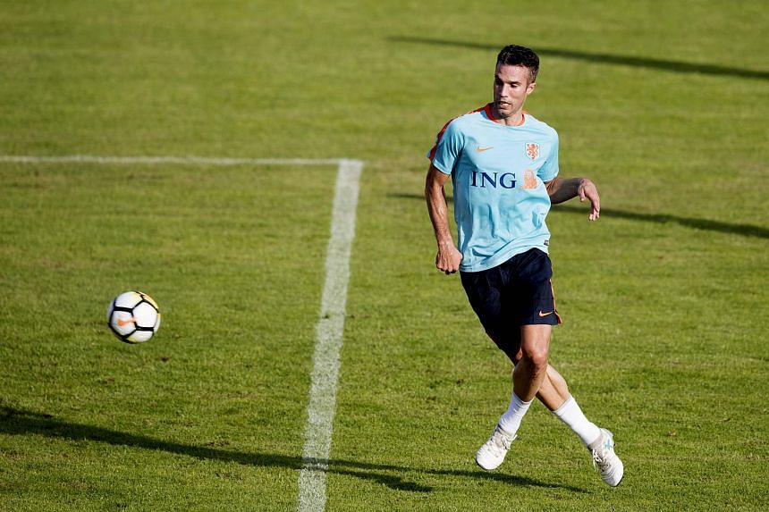 Dutch striker Robin van Persie kicks a ball during a training session in Katwijk on Aug 28, 2017.