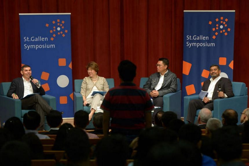Panellists (from left) Warren Fernandez, Janet Ang and Patrick Tay, with moderator Viswa Sadasivan at the  St Gallen Symposium 2018 Singapore Forum panel discussion, on Jan 13, 2018.