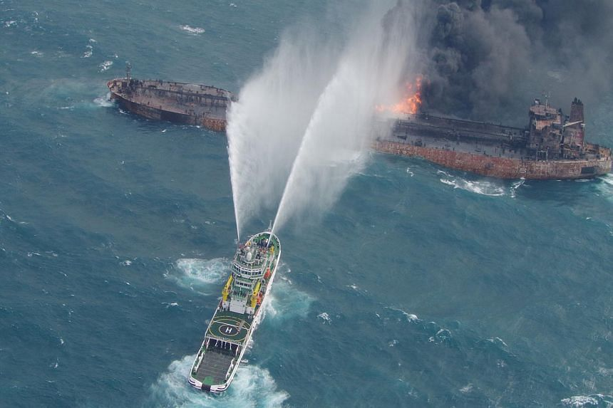 A rescue ship works to extinguish the fire on the Iranian oil tanker Sanchi in the East China Sea, on Jan 10, 2018.