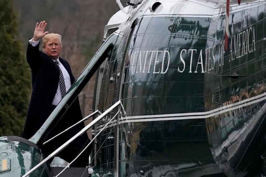 US President Donald Trump waves from the steps of Marine One helicopter upon his departure after his annual physical exam, on Jan 12.